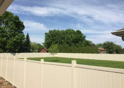 vinyl fenced in backyard