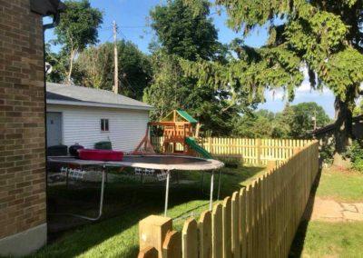 wood fence trampoline