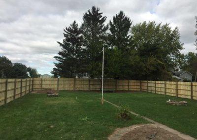 wood fence flag pole